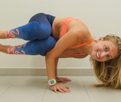Side Crow Parsva Bakasana prepping and propping to fly by Debby Siegel, RYT