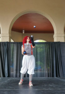 Lucy the clown will be playing around at Manifest Station a family friendly yoga vacation.